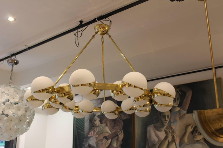 Italian twenty globes circle chandelier, brass and opaline glass, two rows of ten lights.
