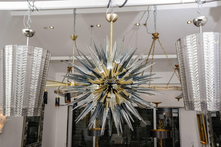 Italian Sputnik chandelier in spiked smoked grey, amber color and clear Murano glass (118 elements). Murano blown glass in a traditional way. With brass fixture and centre of sphere. 12 bulbs.