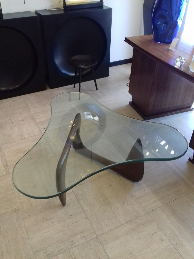 Coffee table attributed to Isamu Noguchi, free-form thick glass top, solid walnut base.