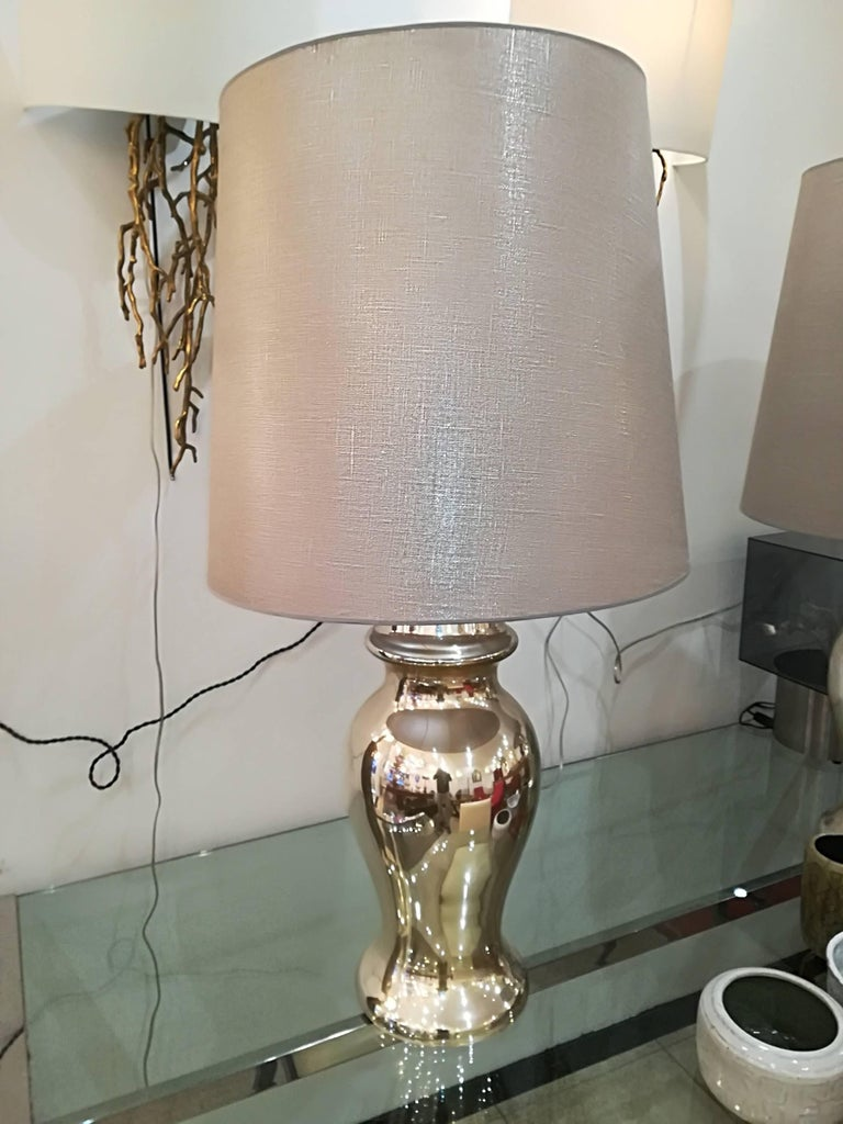 Beautiful pair of eglomized  (silver with with golden highlights ) table lamps, in excellent condition, provided with lampshades. Dim lamp stand only : 57cm