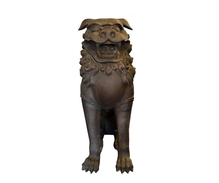 These two bronze Foo Dogs are a great size for displaying aside an entrance door or fireplace. The patina differs slightly between the two but they are truly meant to be displayed together as a pair. They have very good details and most importantly