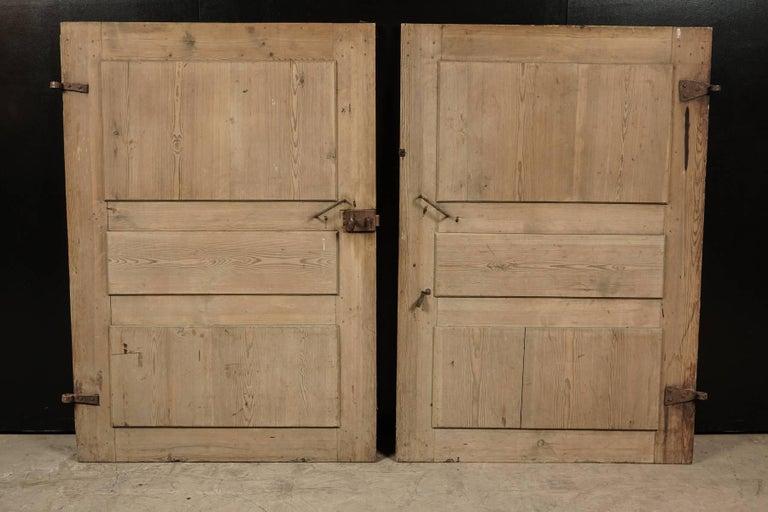Pair of Primitive doors from Sweden, circa 1820. Solid pine doors with original hardware.