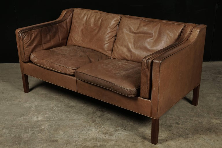 Borge Mogensen two-seat sofa in brown leather, model 2213. Manufactured by Fredericia Furniture, Denmark. Leather with nice patina and wear.