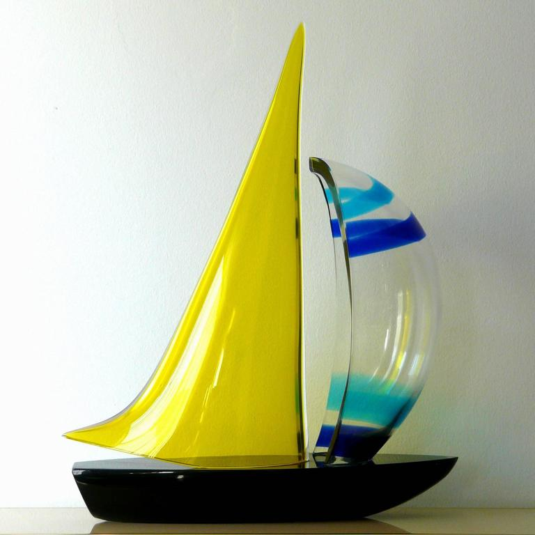 "Murano sailboat by Romano Dona'.Signed ""Murano"" on the base of the boat."