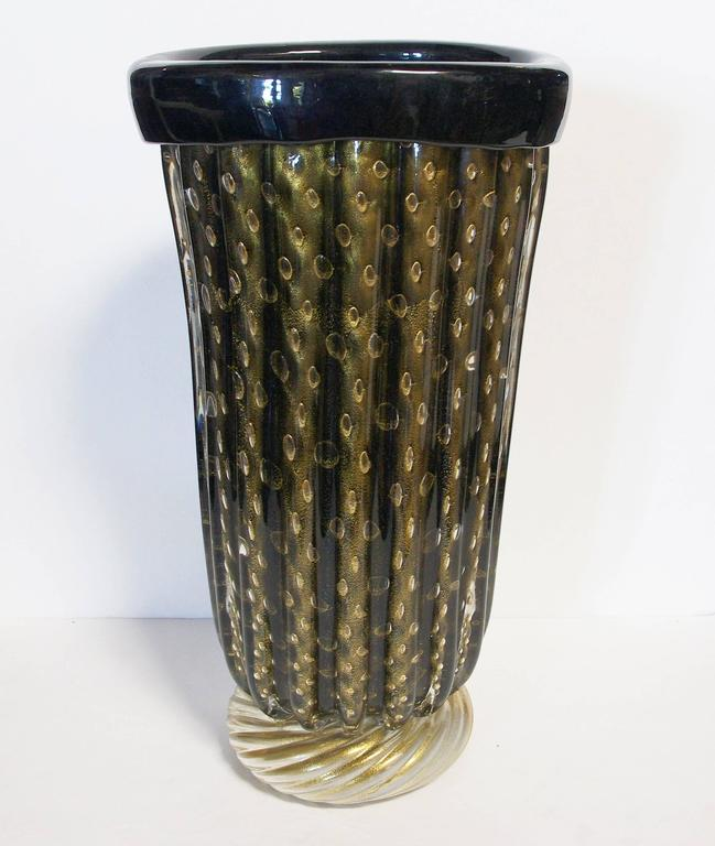 Vintage Italian vases with black and gold Murano glass, by Pino Signoretto. Signed on the base. / Made in Italy in the 1960's.  Depth: 7 inches / Width: 8 inches / Height: 15 inches 2 in stock in Palm Springs currently ON SALE for $3,399!!! Please