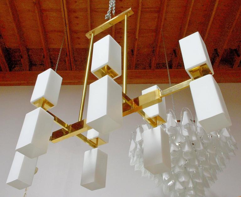 Italian Murano frosted glass and brass chandelier by Fabio Bergomi.  12 light sockets and wired for U.S. 1 in stock, can also be custom ordered from Italy. Sale price refers to the display model, not for custom orders.