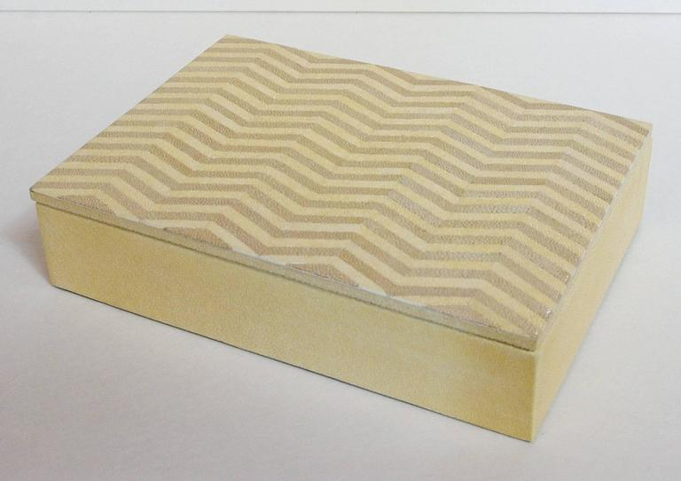 Thai ivory and brown Shagreen box with zigzag pattern and gray suede interior by Fabio Bergomi / Made in Thailand in 2016 Depth: 7 inches / Width: 10 inches / Height: 2.5 inches 1 in stock in Palm Springs currently ON SALE for $799!!! Order