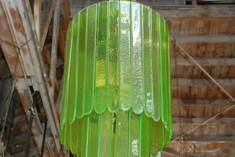 Vintage Italian chandelier with green Murano glasses tiered on chrome metal frame to produce a cascade effect / Designed by Leucos circa 1970's / Made in Italy 9 lights / E26 or E27 type / max 60W each Diameter: 20 inches / Height: 39 inches plus