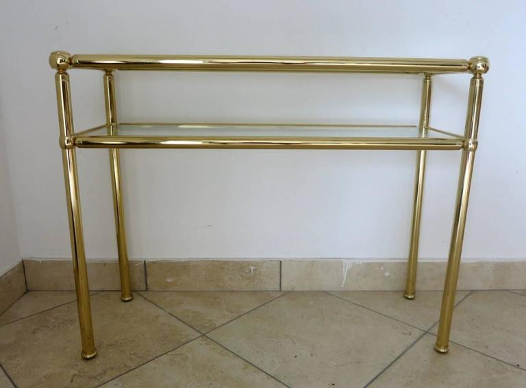 Italian mid-century brass console table / Made in Italy in the 1950's Length: 38.5 inches / Width: 14 inches / Height: 30 inches 2 in stock in Palm Springs currently ON SALE for $1,599 each!!! Order Reference #: F2