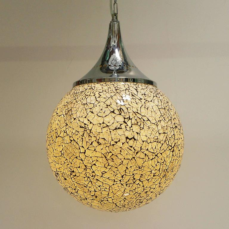 Crackled white glass globe pendants. 1 light / max 40W each Diameter: 12 inches / Height: 18 inches 4 in stock in Palm Springs Order Reference #: C252