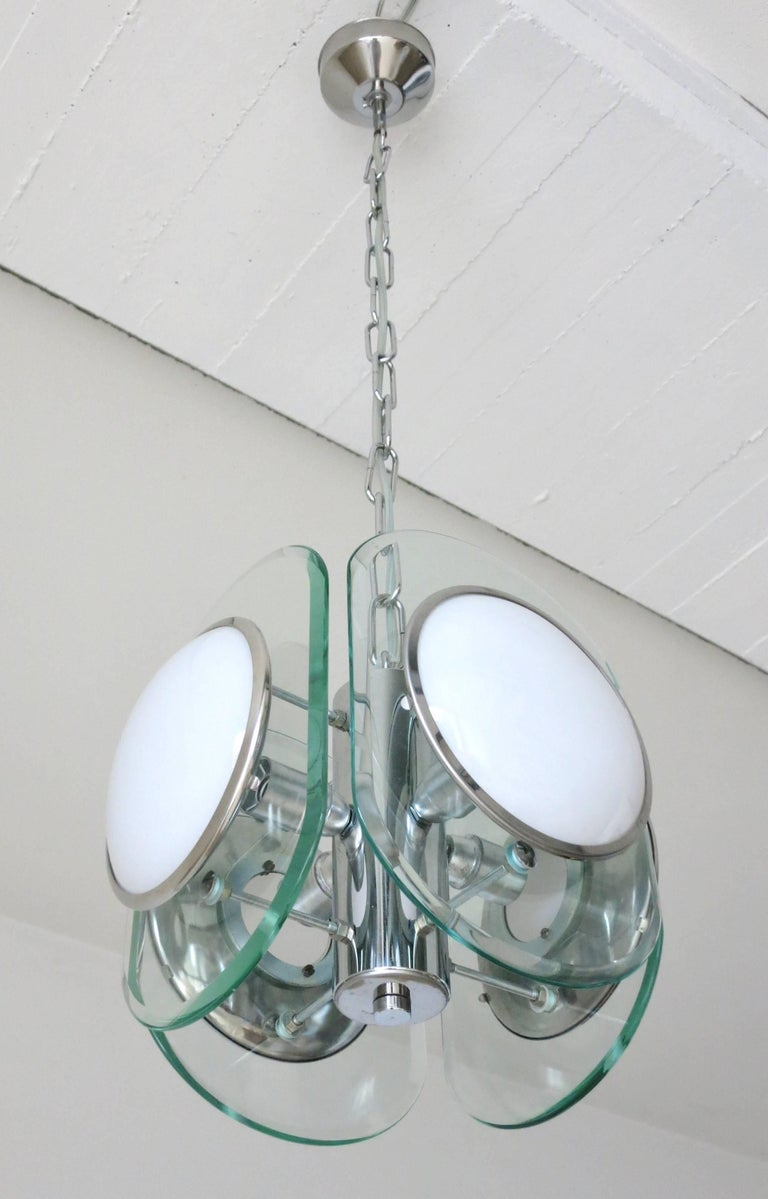 Vintage Italian pendant with four white glass disks and four clear beveled glass disks, mounted on chrome frame / In the style of Fontana Arte / Made in Italy circa 1960's 4 lights / E12 or E14 type / max 40W each Diameter: 11 inches / Height: 12.5