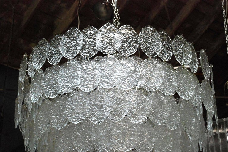 Vintage Italian chandelier with clear Murano oval discs mounted on a nickel frame, made in Italy, circa 1960s 28 lights / E26 or E27 type / max 60W each Measures: Diameter 44 inches, height 44 inches plus chain and canopy 1 in stock in Palm Springs