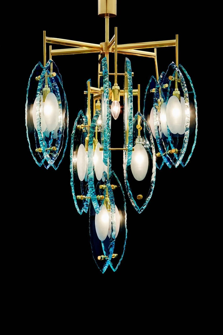 Limited edition Italian chandelier with thick etched glasses, mounted on polished brass frame / Exclusively designed by Gianluca Fontana for Fabio Ltd / Made in Italy 10 lights / E12 or E14 type / max 40W each Diameter: 28 inches / Height: 44 inches