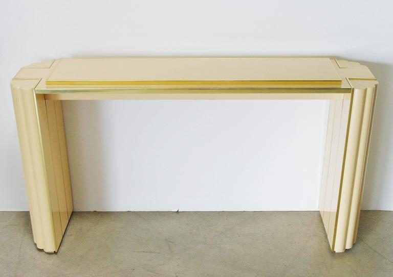 Lacquered console table by Alain Delon for Maison Jansen.