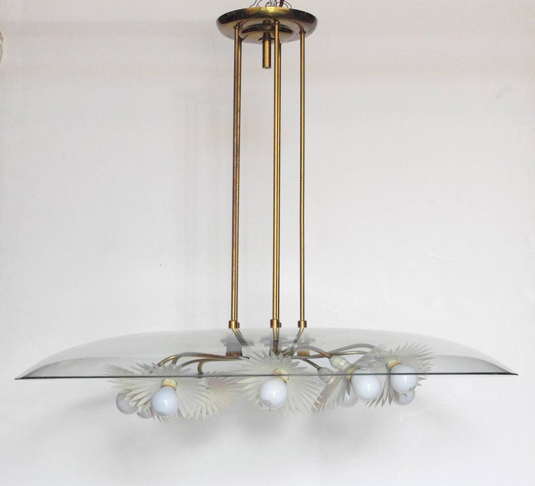 Italian chandelier with beveled glass, brass, and painted aluminum. Designed by Pietro Chiesa, manufactured by Fontana Arte, circa 1948 / Made in Italy Currently all parts are in original condition including the light sockets which are not in