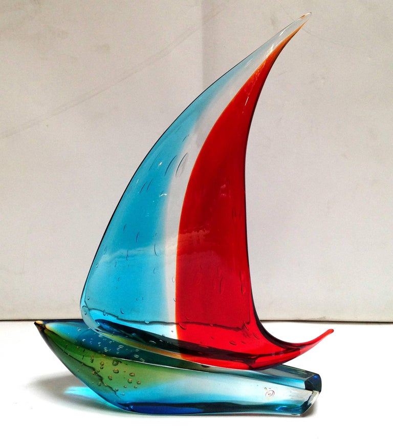 Italian vintage single sail boat hand blown and crafted in red, blue, and yellow Murano glass by Sergio Constantini, signed on the base / Made in Italy in the 1960's Depth: 4 inches / Width: 14.5 inches / Height: 19 inches 1 in stock in Palm Springs