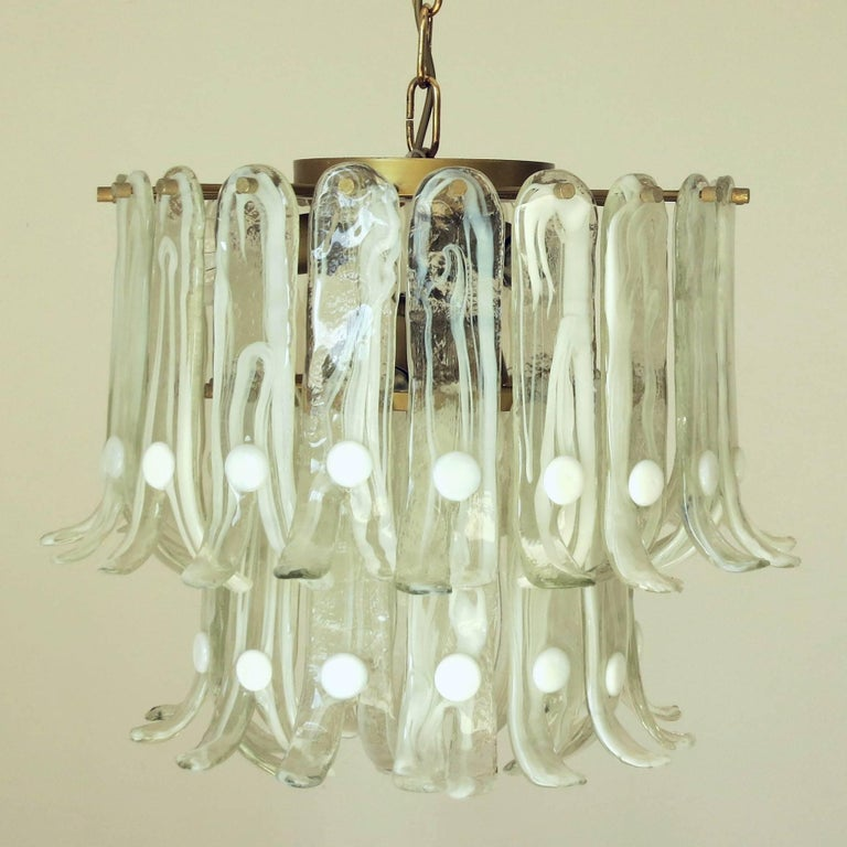 Mid-Century Italian vintage chandelier with green Murano glass petals and brass frame by Mazzega. / Made in Italy in the 1960's. 6 lights / max 40W each Diameter: 18 inches / Height: 18 inches including chain 1 in stock in Palm Springs currently ON