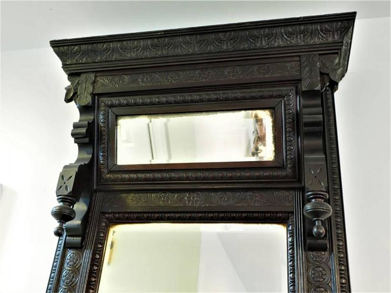 In very good condition with two-part beveled mirror and two built-in candle stands.