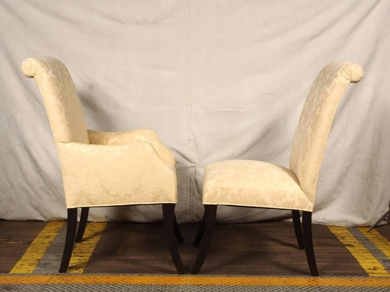In very good condition with great style, good weight and comfort. Solid construction with black lacquer sabre legs and impeccable upholstering. Very comfortable. There is a minor mark or two on the Damask fabric and the sabre legs have wear marks