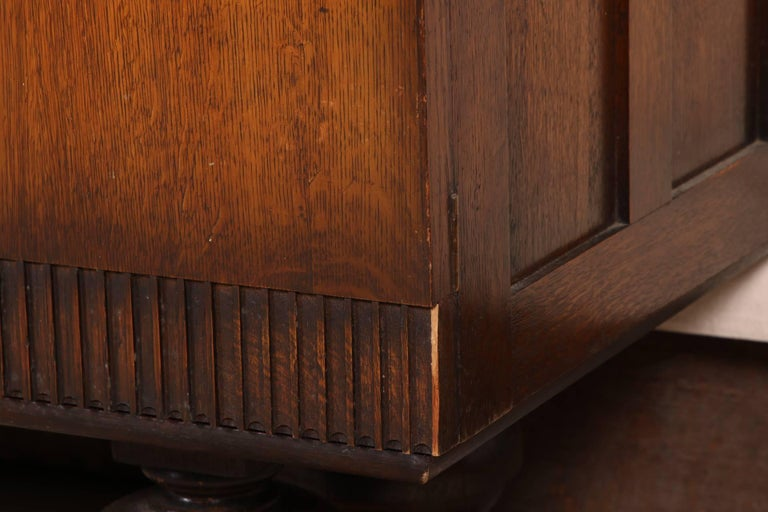 20th Century French Art Deco Carved Oak Cabinet For Sale