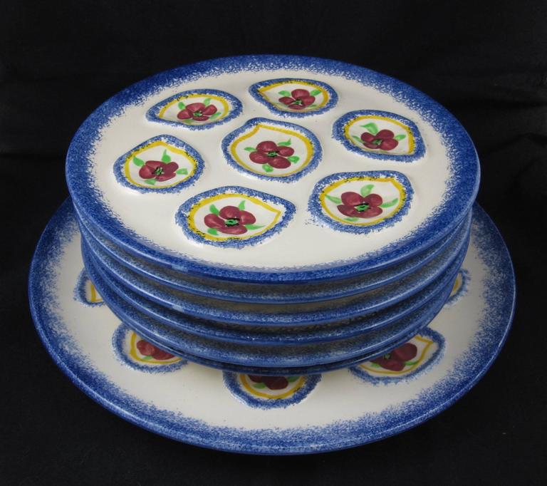 A charming vintage, 1960s French Oyster service, a master server plus six plates, marked St.-Pol-De-Leon. Saint-Pol-de-Léon is a commune in the Finistère department in Brittany in north-western France, located on the coast and known for its