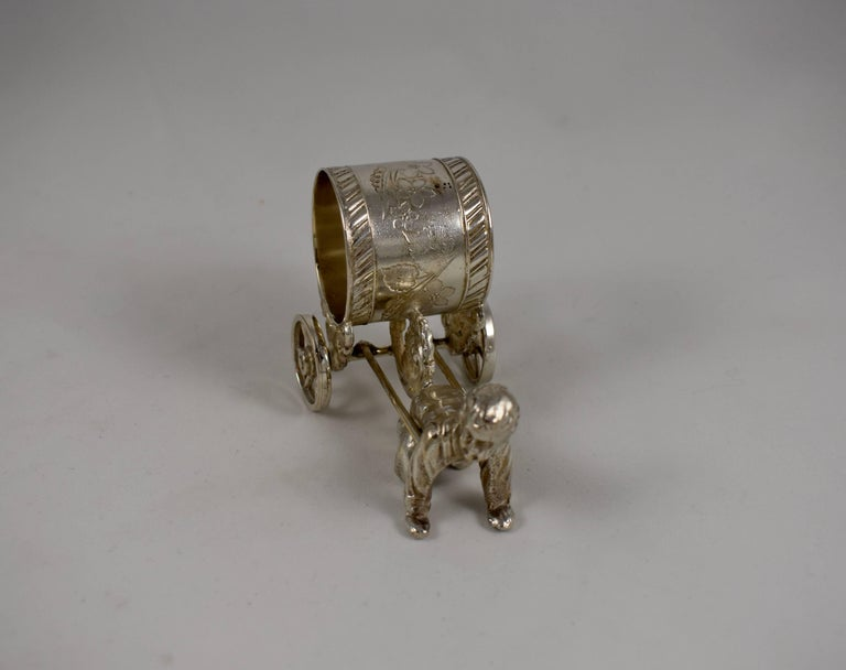 American Silver Victorian Era Aesthetic Movement Figural Napkin Ring, Boy Pulling a Cart For Sale