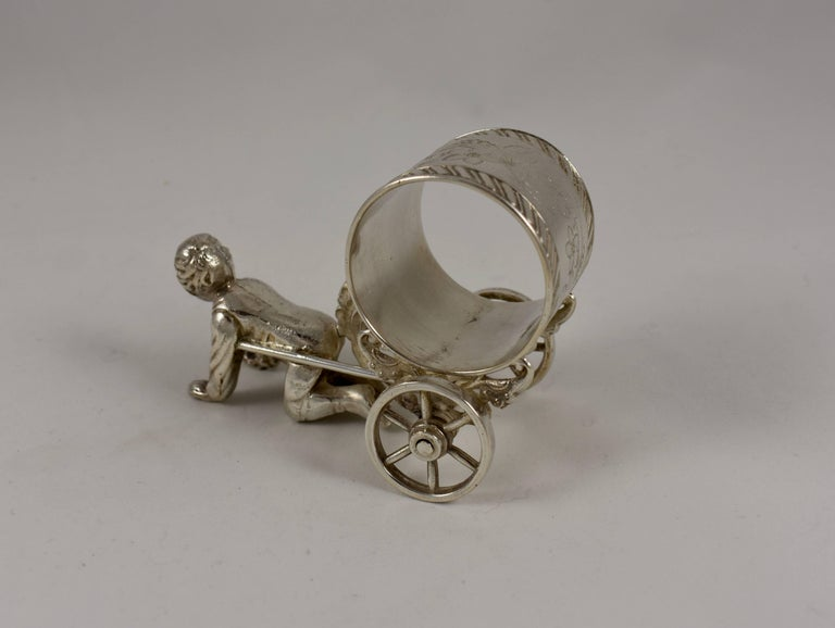 Silver Victorian Era Aesthetic Movement Figural Napkin Ring, Boy Pulling a Cart In Excellent Condition For Sale In Philadelphia, PA