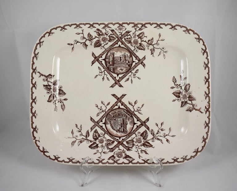 An Aesthetic Movement platter, Whitaker & Co, Hanley, Staffordshire, England, circa 1886-1892.  The Japanesque 'Alaska' pattern is transfer printed in brown on a cream earthenware body and shows a running crossed twig border of flowering fruit