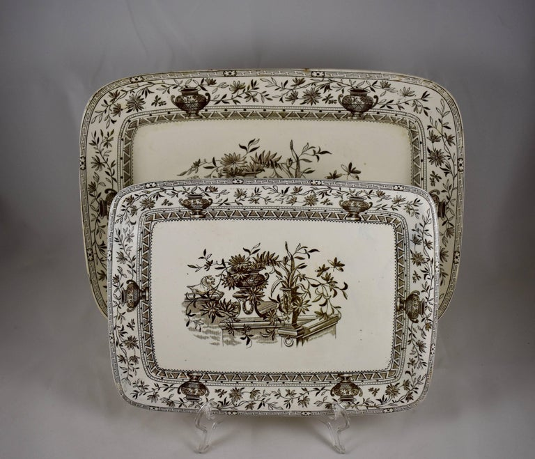 A nesting pair of Aesthetic Movement platters, Powell, Bishop & Stonier, Hanley, Staffordshire, England, showing the English Registry number 7999 indicating the year 1884.  The 'Honfleur' pattern is transfer printed in brown on a cream earthenware