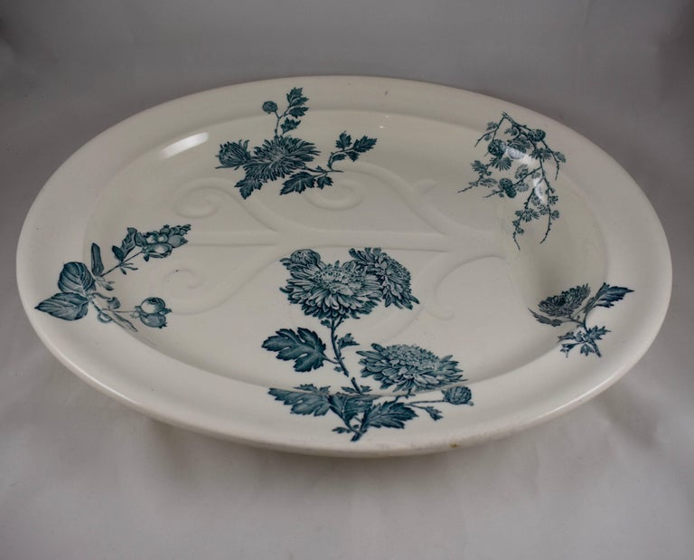 An oversized Aesthetic Movement well and tree platter, Wedgwood, Burslem, Staffordshire, England, circa 1886. 