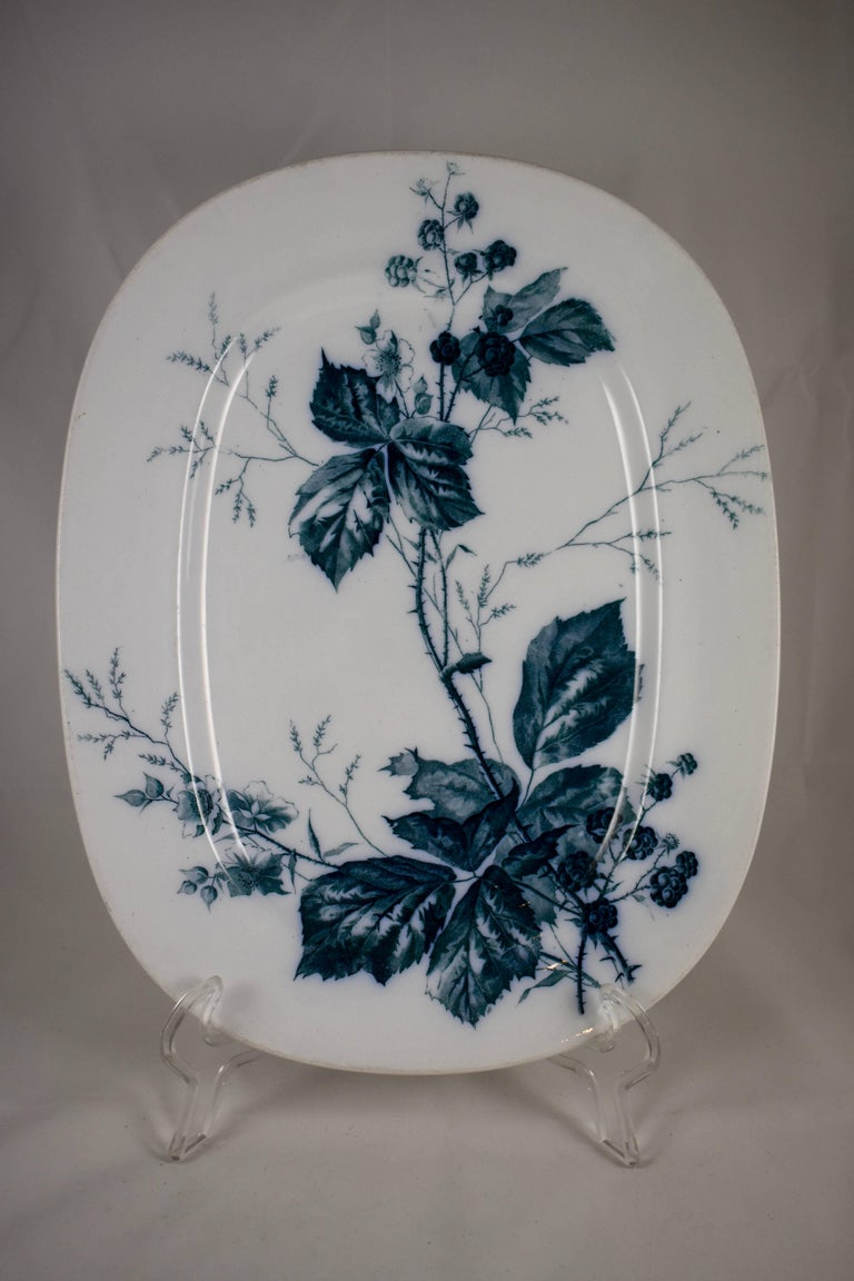 "A German Aesthetic Movement platter, transfer printed in blue-green or teal on a white body, the ""Rubus"" pattern, showing aspects of the Blackberry plant.