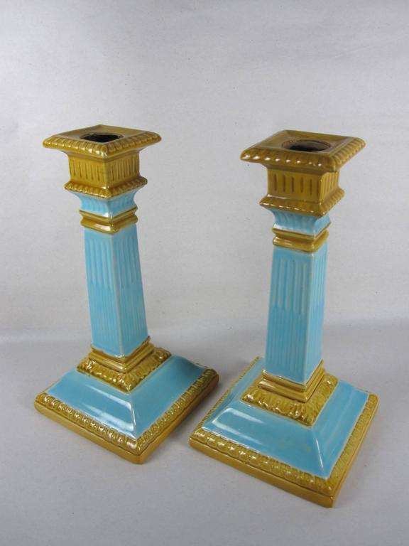 A scarce pair of Majolica glazed neoclassical column-form candlesticks by William Brownfield & Son, Cobridge, Stoke-on-Trent, Staffordshire, England, circa 1892.