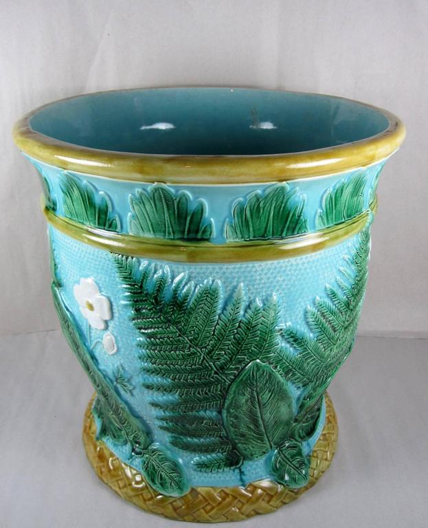 An oversized John Adams & Co., later known as Adams & Bromley, English majolica jardinière with a leaf, fern and floral theme, manufactured in 1871. This piece would have been at home in a Victorian English Garden Conservatory.   Brightly colored