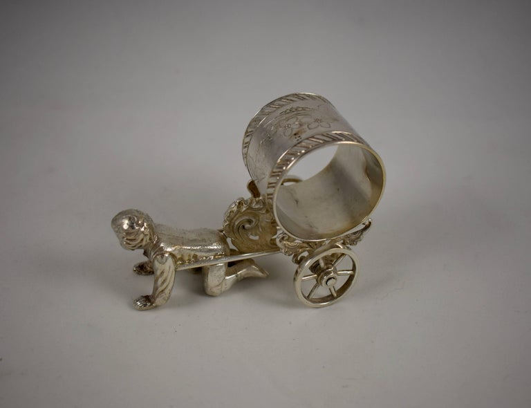 Cast Silver Victorian Era Aesthetic Movement Figural Napkin Ring, Boy Pulling a Cart For Sale