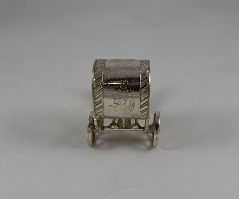 Silver Plate Silver Victorian Era Aesthetic Movement Figural Napkin Ring, Boy Pulling a Cart For Sale