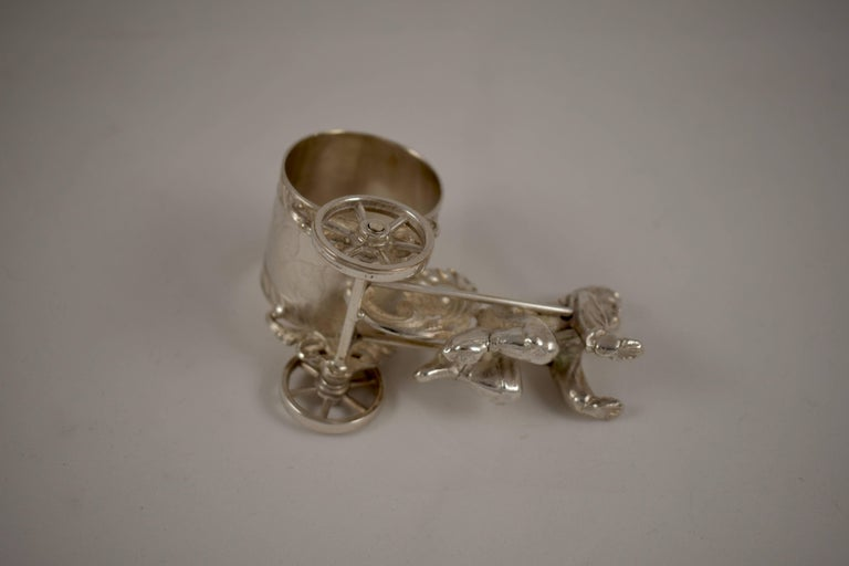 Silver Victorian Era Aesthetic Movement Figural Napkin Ring, Boy Pulling a Cart For Sale 1