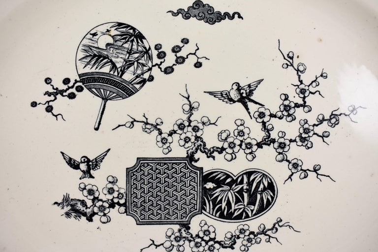 A large Aesthetic Movement platter, Thomas Furnival & Sons, Cobridge, Staffordshire, England, circa 1879.