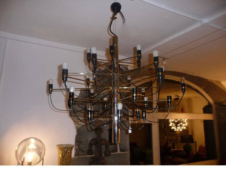 2097/30 suspension Arteluce (after purchased by Flos), established in 1958 by Gino Sarfatti. 2097. Central structure is made of iron chrome and brass arms.