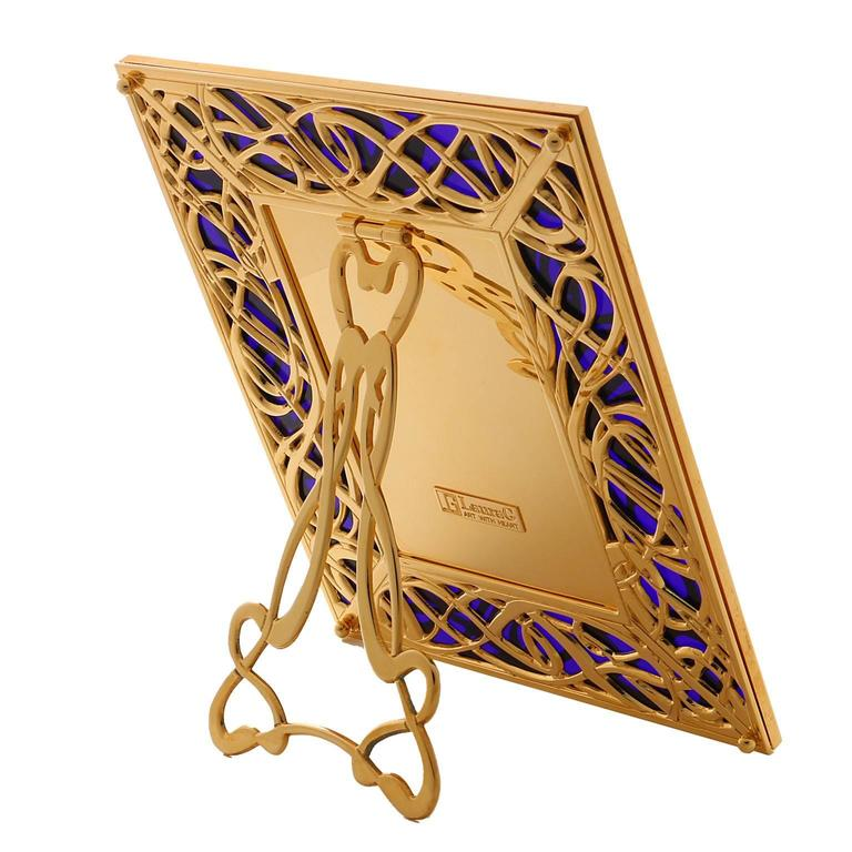 Illumination blue is a golden bronze picture frame with blue murano glass. A Classic Art Nouveau motif meanders in relief on a background of blue Murano glass. Illumination blue is an art-design picture frame, proudly handmade in Italy by master of