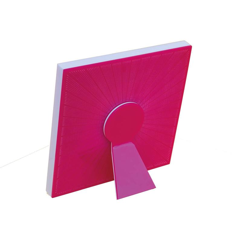 Sharing Shocking Pink  is a limited edition of Art with Heart collection of recto-verso photo frames by Laura G Italy. It is realized in shocking pink  and white artistic plexiglass , with guillochè rays hand worked into shocking pink flou plexi,