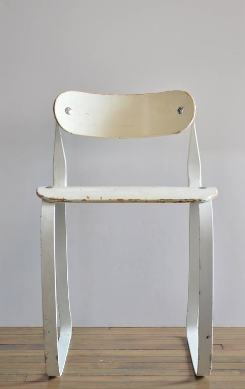 Originally designed by Herman Sperlich for the Ironrite Corporation, this chair is an example of early ergonomic design and was originally designed to be used by factory workers. Now it is considered a collector's item, and is included in the