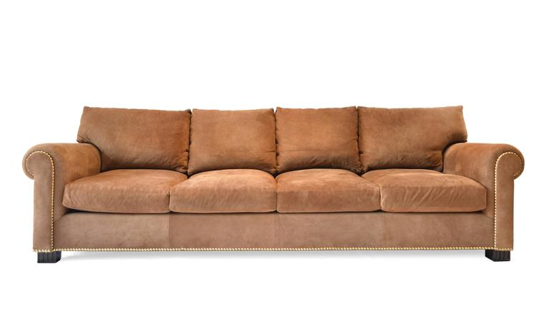 Tan Suede Sofa With Deep Comfortable Seats And Nailhead Trim Detailing.  Made By Ralph Lauren