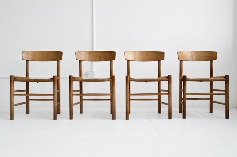 Set Of Four Borge Mogensen Wood And Rush Dining Chairs Mid 20th