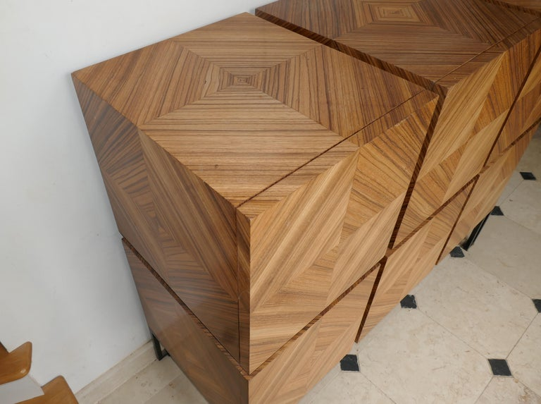Chest of drawers in Zebrano Build with 13 scares Zebrano marquetry open in tow big drawers. Leg are in black painted metal. the frame is built in oak and tinted black. We can you a sample of the zebrano.
