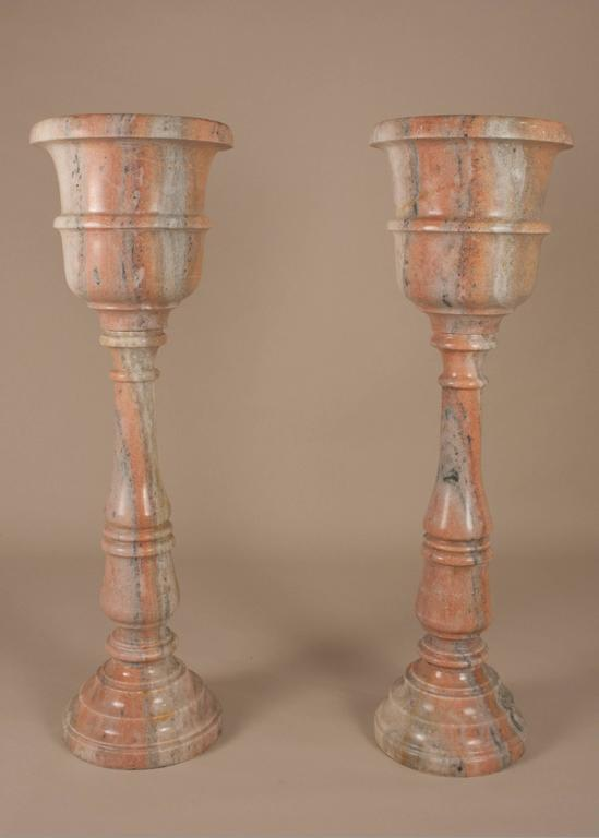 Pair of Udaipur pink marble standing jardinieres, each comprised of three pieces. These Mid-Century planters have beautiful grain, with a palette of salmon pink and gray tones.
