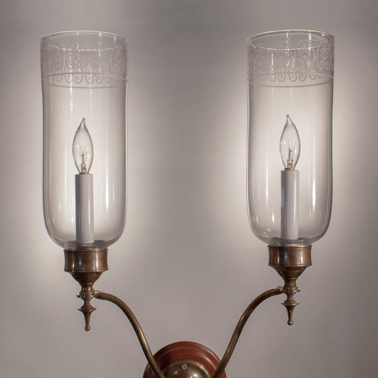 Pair of Double Arm Glass Hurricane Shade Wall Sconces For Sale at 1stdibs