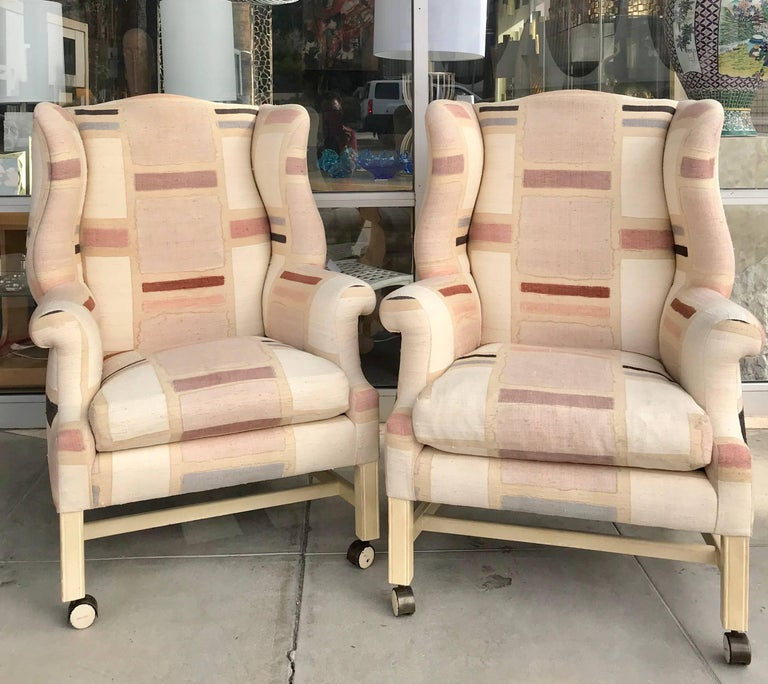 A modern take on a Wing Chair done in amazing hand painted raw silk were from a multi million dollar Palm Springs area estate. They are on custom made casters and were originally designed for a game table in the living room of the home. very chic