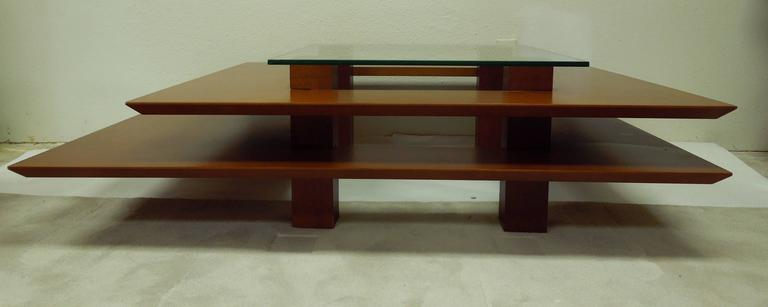 An architectural coffee table designed by French artist Clemmer Heidsieck. Purchased in nice, France. Combination of beech veneer and ashwood. Square glass tired top.