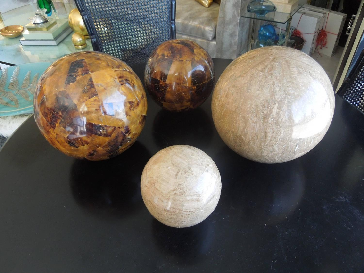 Set of four maitland smith tessellated stone spheres for