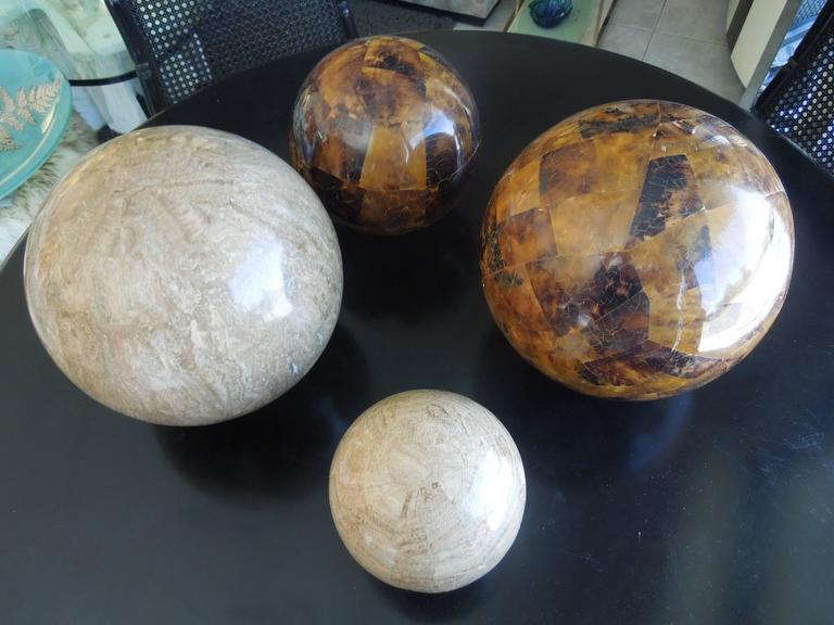 From a very upscale estate in Palm Springs, CA are a set of rare tessellated stone spheres. Two are in travertine stone and two rare dark brown color stone. They were made by hand in the Philippines for Maitland smith. They appear perfectly round on